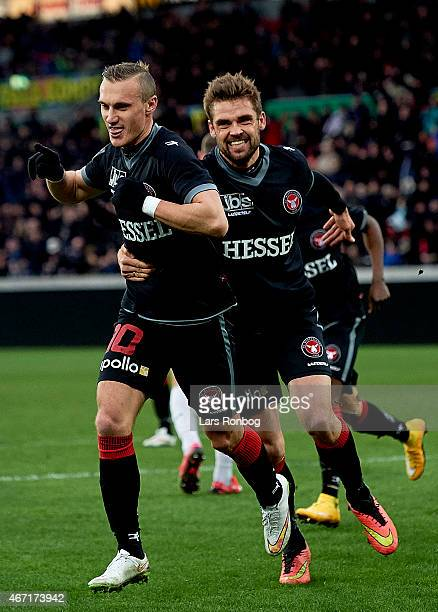 Martin Pusic of FC Midtjylland celebrates with team mate Jim Larsen after scoring their first goal during the Danish Alka Superliga match between FC...