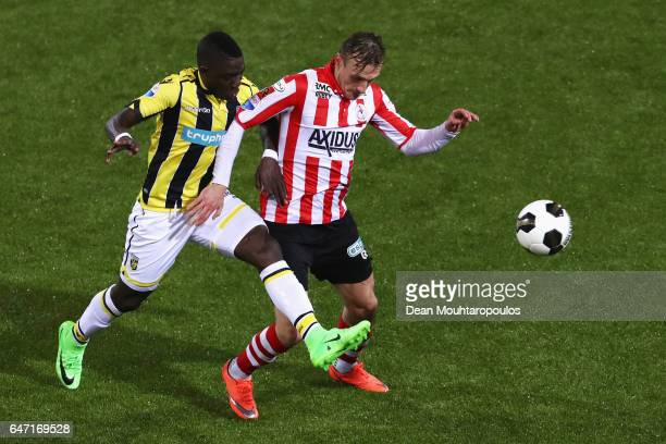 Martin Pusic of Sparta Rotterdam battles for the ball with Marvelous Nakamba of Vitesse Arnhem during the Dutch KNVB Cup Semifinal match between...