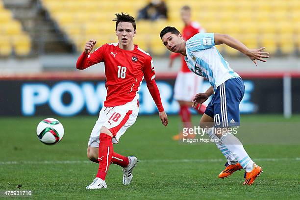 Martin Rasner of Austria passes under pressure from Tomas Martinez of Argentina during the FIFA U20 World Cup New Zealand 2015 Group B match between...