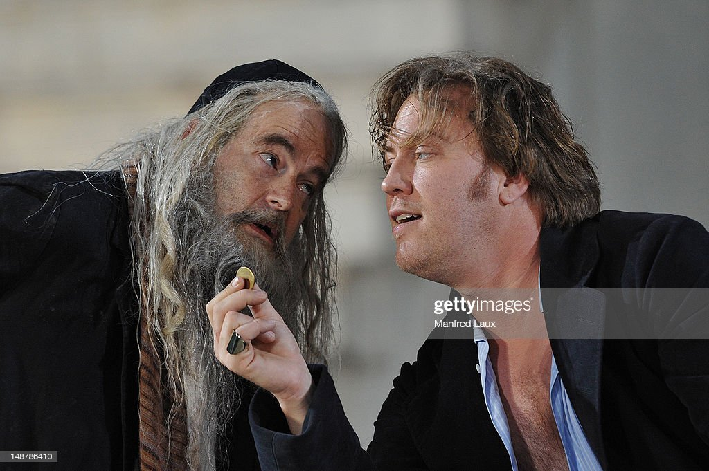 Martin Reinke (God/Poor Neighbour) (L) , and Nicolas Ofczarek (Everyman) is seen during the photo rehearsal of 'Jedermann' (Everyman) on the Domplatz ahead of Salzburg Festival 2012 on July 19, 2012 in Salzburg, Austria. The Salzburg Festival 2012 will run from July 20 until September 2.