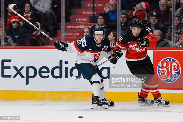 Martin Reway of Team Slovakia and Jake Virtanen of Team Canada chase the puck during the 2015 IIHF World Junior Hockey Championship game at the Bell...