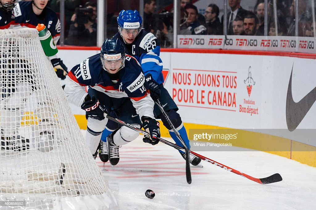 Martin Reway #10 of Team Slovakia chases the puck with <a gi-track='captionPersonalityLinkClicked' href=/galleries/search?phrase=Artturi+Lehkonen&family=editorial&specificpeople=9619074 ng-click='$event.stopPropagation()'>Artturi Lehkonen</a> #28 of Team Finland following behind during the 2015 IIHF World Junior Hockey Championship game at the Bell Centre on December 27, 2014 in Montreal, Quebec, Canada. Team Slovakia defeated Team Finland 2-1.