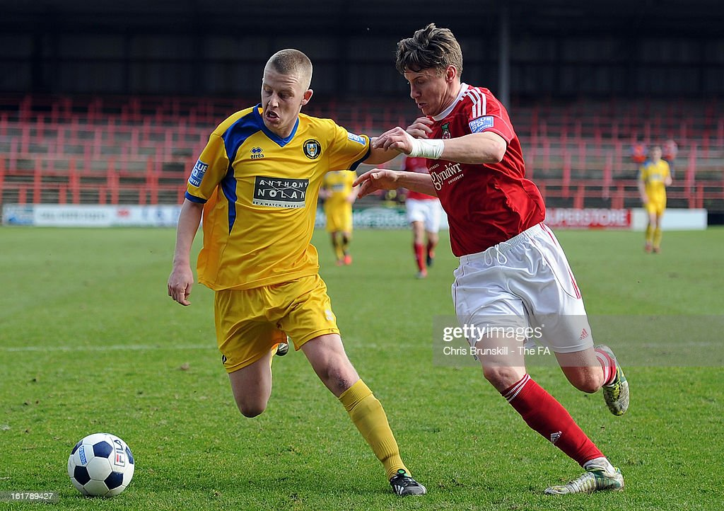 Martin Riley (R) of Wrexham in action with Terry Hawkridge of Gainsborough Trinity during the FA Trophy Semi-Final match between Wrexham and Gainsborough Trinity at the Racecourse Ground on February 16, 2013 in Wrexham, Wales.