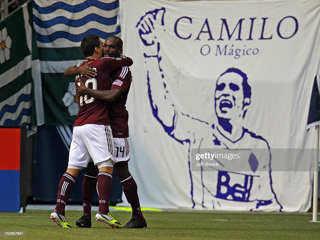 Martin Rivero congratulates goal scorer Omar Cummings of the Colorado Rapids against the Vancouver Whitecaps FC during the MLS game September 23 2012...