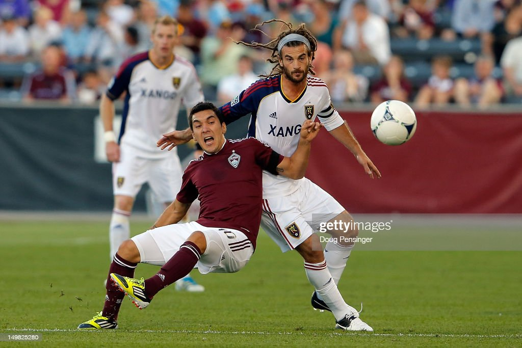 Martin Rivero #10 of Colorado Rapids is fouled by <a gi-track='captionPersonalityLinkClicked' href=/galleries/search?phrase=Kyle+Beckerman&family=editorial&specificpeople=578059 ng-click='$event.stopPropagation()'>Kyle Beckerman</a> #5 of Real Salt Lake as they battle for control of the ball at Dick's Sporting Goods Park on August 4, 2012 in Commerce City, Colorado.