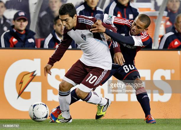 Martin Rivero of the Colorado Rapids and Fernando Cardenas of the New England Revolution battle for the ball during the first half at Gillette...