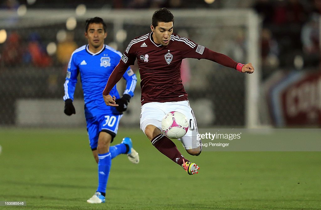 Martin Rivero of the Colorado Rapids controls the ball against Rafael Baca of the San Jose Earthquakes at Dick's Sporting Goods Park on October 6...