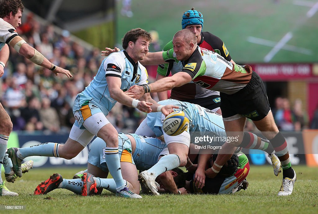 Martin Roberts of Northampton passes the ball as Mike Brown attempts to intercept during the Aviva Premiership match between Harlequins and Northampton Saints at Twickenham Stoop on May 4, 2013 in London, England.