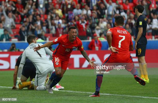 Martin Rodriguez of Chile celebrates scoring his sides first goal with Alexis Sanchez of Chile during the FIFA Confederations Cup Russia 2017 Group B...