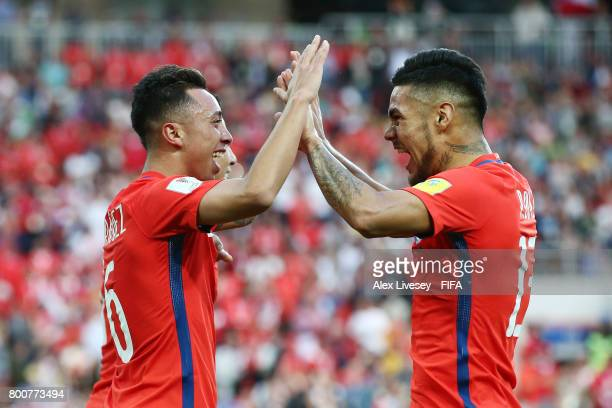 Martin Rodriguez of Chile celebrates scoring his sides first goal with Paulo Diaz of Chile during the FIFA Confederations Cup Russia 2017 Group B...
