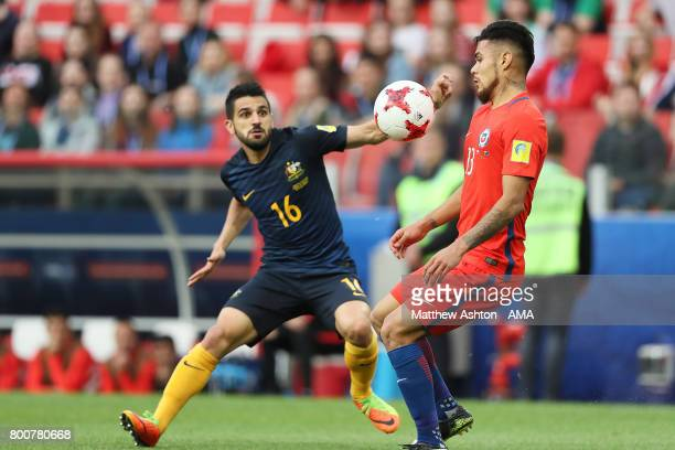 Martin Rodriguez of Chile competes with Aaron Mooy of Australia during the FIFA Confederations Cup Russia 2017 Group B match between Chile and...