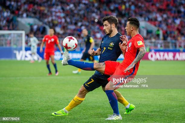 Martin Rodriguez of Chile competes with Mathew Leckie of Australia during the FIFA Confederations Cup Russia 2017 group B football match between...