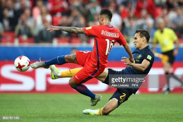 Martin Rodriguez of Chile scores his team's opening goal challenged by Trent Sainsbury of Australia during the FIFA Confederations Cup Russia 2017...