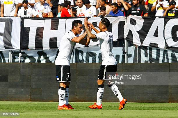 Martin Rodriguez of Colo Colo celebrates with Esteban Paredes after scoring the opening goal during a match between Colo Colo and U de Concepcion as...