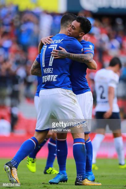 Martin Rodriguez of Cruz Azul celebrates with teammates after scoring the first goal of his team during the 12th round match between Pumas UNAM and...