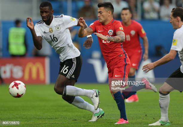 Martin Rodriguez of the Germany national football team and Charles Aranguiz of the Chile national football team vie for the ball during the 2017 FIFA...