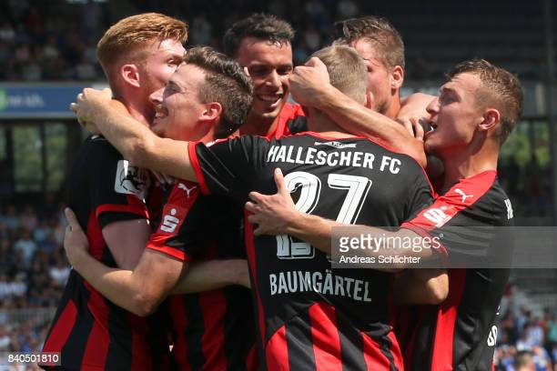 Martin Roeser celebrate with team during the 3 Liga match between Karlsruher SC and Hallescher FC at on August 26 2017 in Karlsruhe Germany