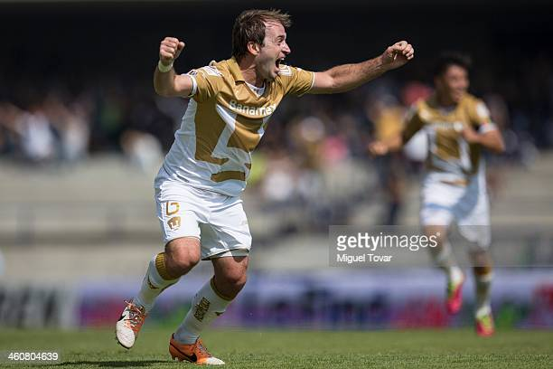 Martin Romagnoli celebrates a scored goal against Puebla during a match between Pumas UNAM and Puebla as part of the Clausura 2014 Liga MX at...