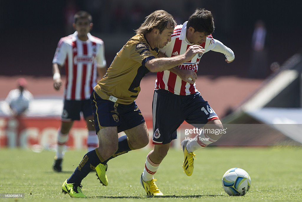 Martin Romagnoli of Pumas fights for the ball with Luis Morales of Chivas during a match between Pumas and Chivas as part of the Clausura 2013 at Olympic stadium on March 03, 2013 in Mexico City, Mexico.
