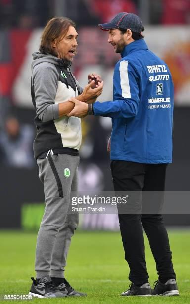 Martin Schmidt head coach of Wolfsburg talks with Sandro Schwarz head coach of Mainz after the Bundesliga match between VfL Wolfsburg and 1 FSV Mainz...