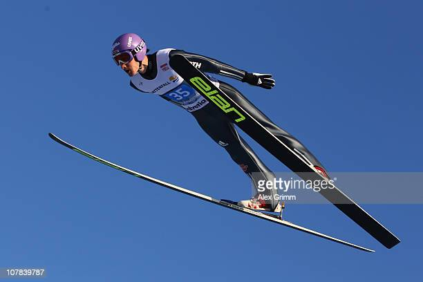 ARY 01 Martin Schmitt of Germany competes during the first round for the FIS Ski Jumping World Cup event at the 59th Four Hills ski jumping...