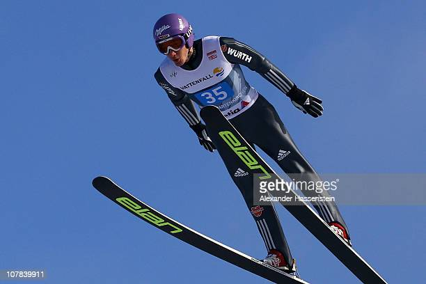 Martin Schmitt of Germany competes during the first round for the FIS Ski Jumping World Cup event at the 59th Four Hills ski jumping tournament at...