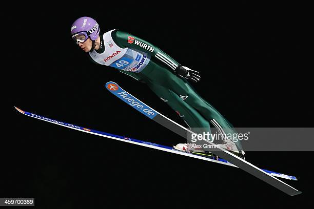 Martin Schmitt of Germany competes during the first round on day 2 of the Four Hills Tournament Ski Jumping event at SchattenbergSchanze on December...
