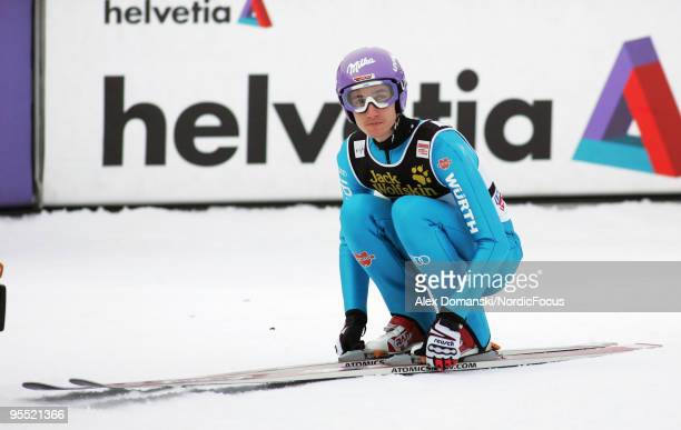 Martin Schmitt of Germany competes during the FIS Ski Jumping World Cup event of the 58th Four Hills Ski Jumping tournament at the Olympiaschanze on...