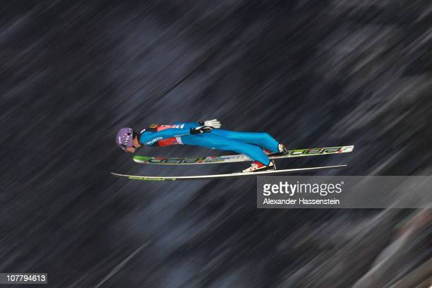 Martin Schmitt of Germany competes during the qualification round for the FIS Ski Jumping World Cup event at the 59th Four Hills ski jumping...