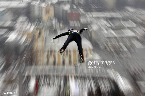 Martin Schmitt of Germany competes during the qualification round for the FIS Ski Jumping World Cup event of the 59th Four Hills ski jumping...