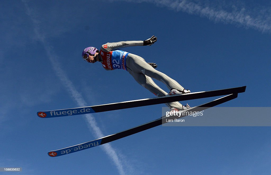 <a gi-track='captionPersonalityLinkClicked' href=/galleries/search?phrase=Martin+Schmitt&family=editorial&specificpeople=226770 ng-click='$event.stopPropagation()'>Martin Schmitt</a> of Germany competes during the trail round for the FIS Ski Jumping World Cup event at the 61st Four Hills ski jumping tournament at Olympiaschanze on December 31, 2012 in Garmisch-Partenkirchen, Germany.