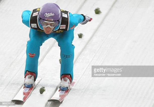 Martin Schmitt of Germany competes during the trial round of the FIS Ski Jumping World Cup event of the 58th Four Hills ski jumping tournament on...