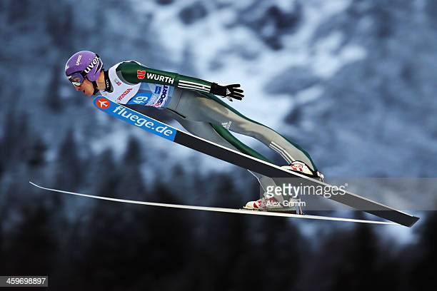 Martin Schmitt of Germany competes during the trial round on day 2 of the Four Hills Tournament Ski Jumping event at SchattenbergSchanze on December...