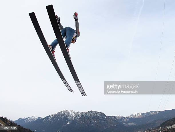 Martin Schmitt of Germany competes during trail round of the FIS Ski Jumping World Cup event of the 58th Four Hills ski jumping tournament at the...