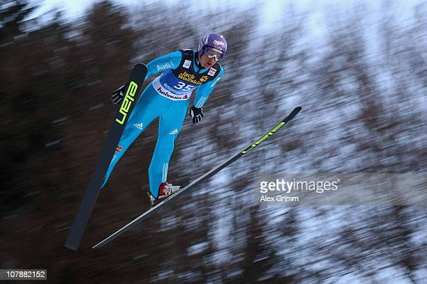 Martin Schmitt of Germany competes during training round for the FIS Ski Jumping World Cup event of the 59th Four Hills ski jumping tournament at...