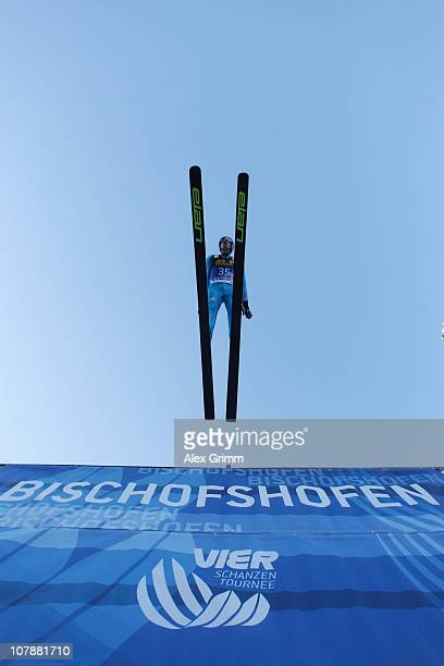 Martin Schmitt of Germany competes during trial round for the FIS Ski Jumping World Cup event of the 59th Four Hills ski jumping tournament at...