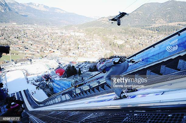 Martin Schmitt of Germany competes in the training jumps on day 1 of the Four Hills Tournament event on December 31 2013 in GarmischPartenkirchen...
