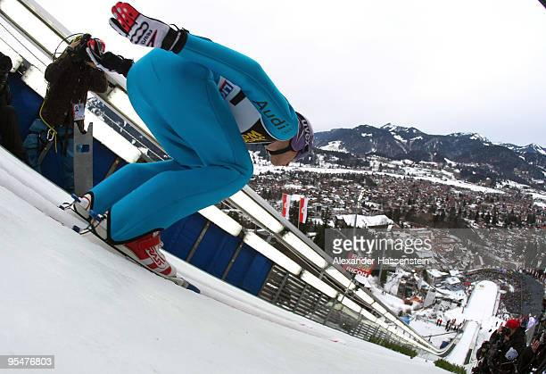 Martin Schmitt of Germany competes in the training round for the FIS Ski Jumping World Cup event at the 58th Four Hills ski jumping tournament at...