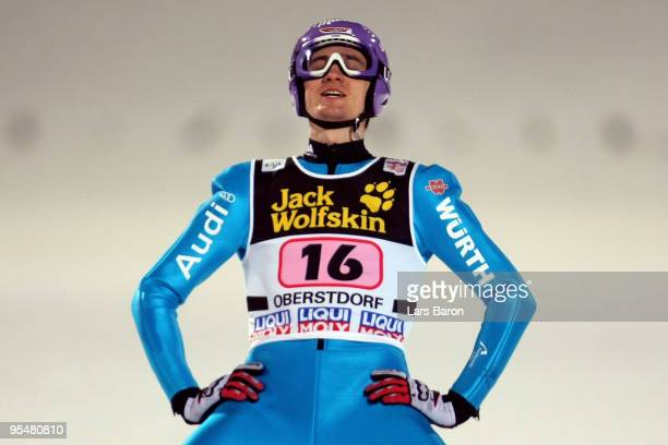 Martin Schmitt of Germany looks dejected after the final round for the FIS Ski Jumping World Cup event at the 58th Four Hills ski jumping tournament...