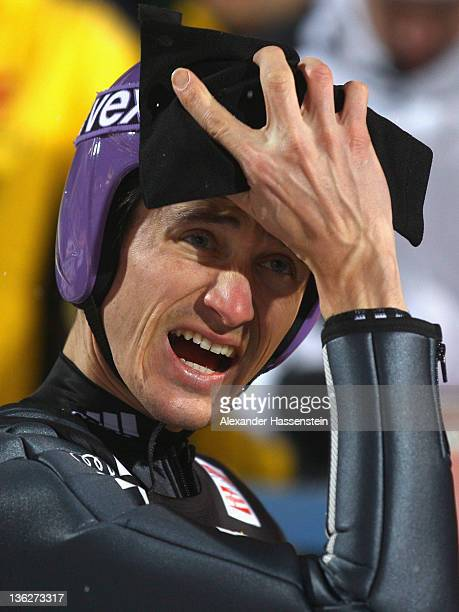 Martin Schmitt of Germany reacts after the first round for the FIS Ski Jumping World Cup event of the 60th Four Hills ski jumping tournament at...