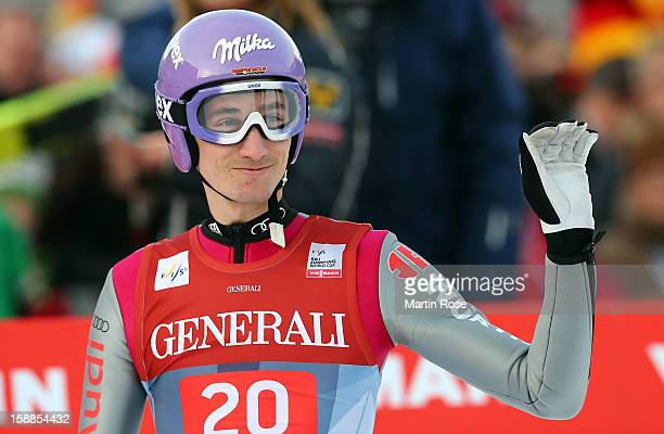 Martin Schmitt of Germany reacts during the final round for the FIS Ski Jumping World Cup event of the 61st Four Hills ski jumping tournament at...