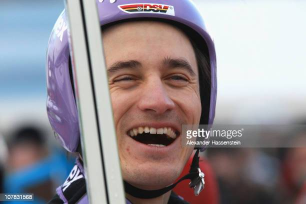 Martin Schmitt of Germany smiles after the qualification round for the FIS Ski Jumping World Cup event at the 59th Four Hills ski jumping tournament...