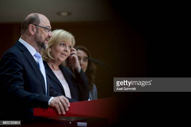 Martin Schulz Chairman and chancellor candidate of the German Social Democrats and North RhineWestphalia SPD lead candidate Hannelore Kraft speak to...
