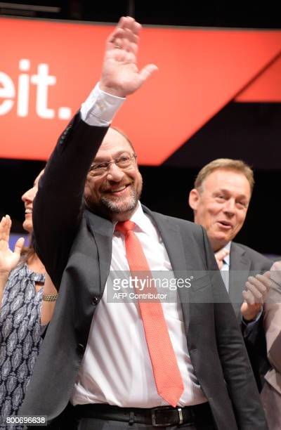 Martin Schulz chairman of Germany's social democraic SPD party and candidate for chancellor waves as he arrives for a party congress in Dortmund...