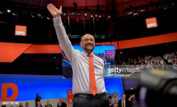 Martin Schulz chairman of Germany's social democraic SPD party and candidate for chancellor waves during a party congress of Germany's social...