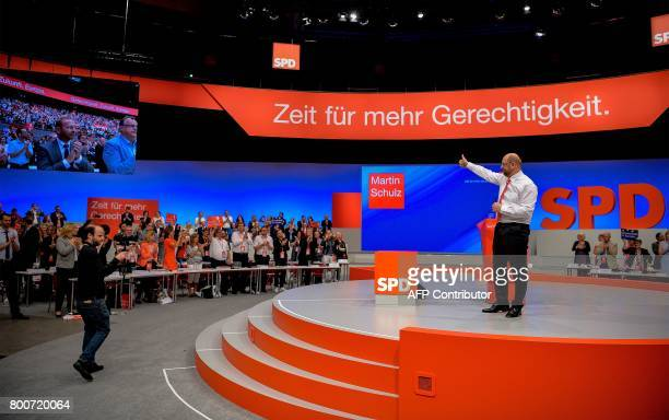 Martin Schulz chairman of Germany's social democratic SPD party and candidate for chancellor holds his thumb up as he is applauded for his speech...