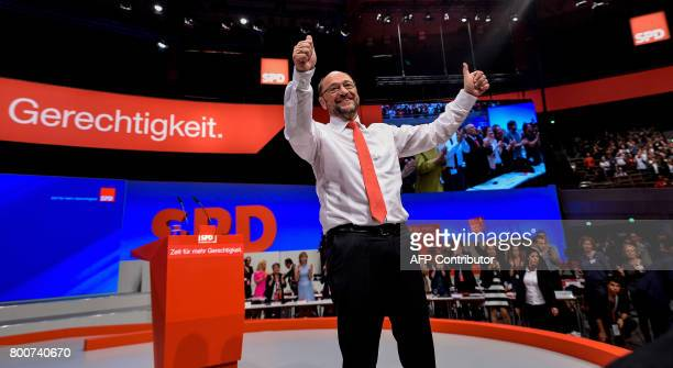 Martin Schulz chairman of Germany's social democratic SPD party and candidate for chancellor poses on stage during an SPD party congress in Dortmund...