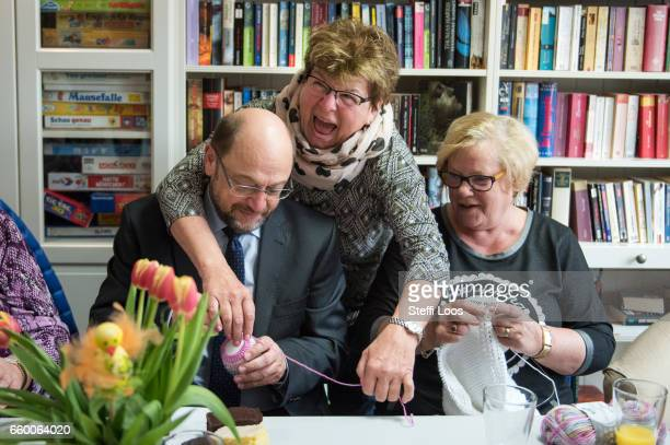 Martin Schulz chairman of the Social Democratic Party of Germany speaks to elderly residents during a visit to the multigenerational house Philantow...