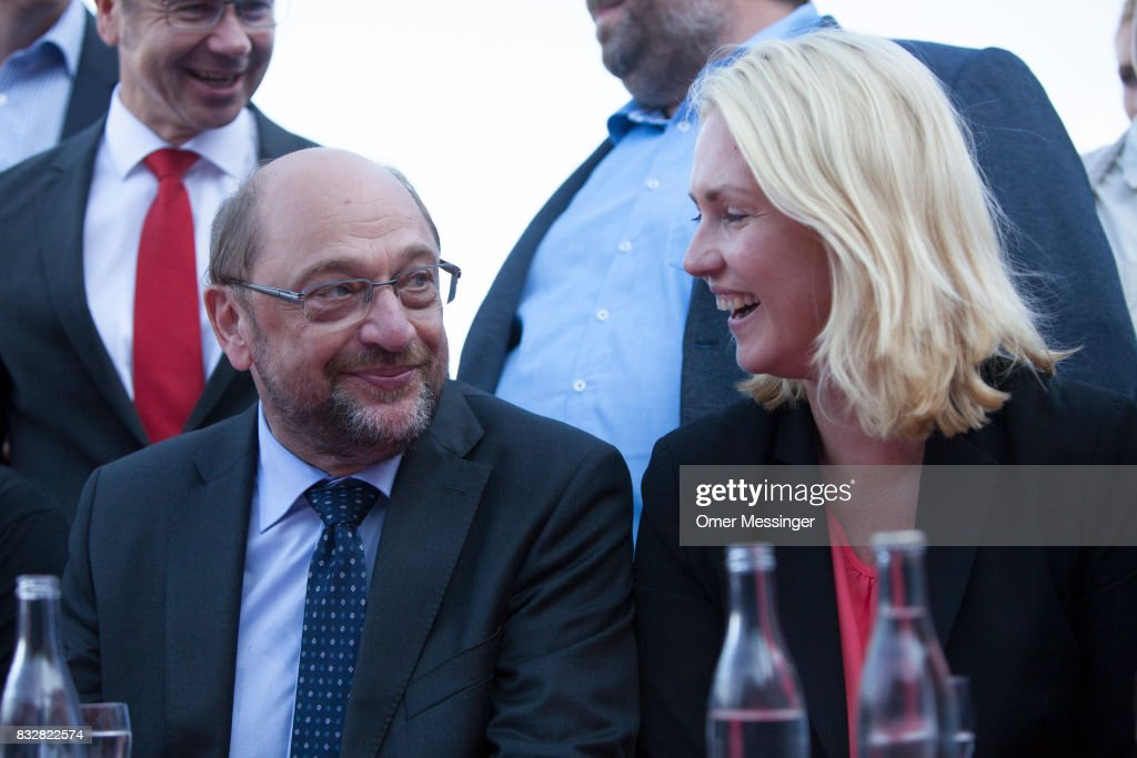 Martin Schulz, chancellor candidate of the German Social Democrats (SPD) (L) and Governor of Mecklenburg-Western Pomerania Manuela Schwesig (R) are seen during an election campaign stop on August 16, 2017 in Stralsund, Germany. Germany is scheduled to hold federal elections on September 24 and Schulz is currently approximately 14 points behind his rival, German Christian Democrat (CDU) and current German Chancellor Angela Merkel, who is seeking a fourth term as chancellor.