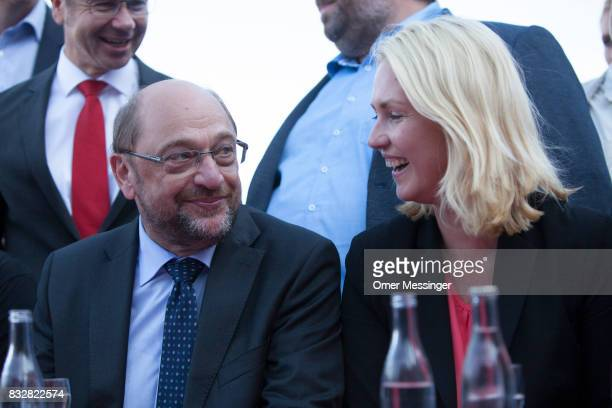 Martin Schulz chancellor candidate of the German Social Democrats and Governor of MecklenburgWestern Pomerania Manuela Schwesig are seen during an...